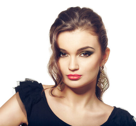 Fashion girl portrait. Evening makeup and hairstyle. Smokey eyes makeup, brown eyes and pink lipstick Stock Photo