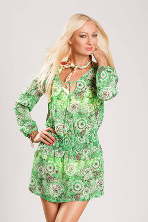 greeen: young blonde woman in greeen beach dress Stock Photo