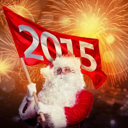 New year coming by Santa Claus. Santa with 2015 flag in firework flashes photo