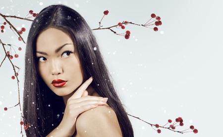 Asian woman beauty face closeup portrait. Beautiful attractive girl with long shiny dark  hairs. Stock Photo