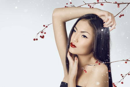 rennet: Asian woman beauty face closeup portrait. Beautiful attractive girl with long shiny dark  hairs. Stock Photo
