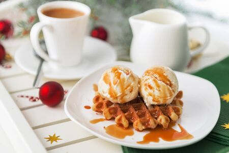 Christmas breakfast. Viennese wafer biscuit with ice-cream and coffee with milk Stock Photo