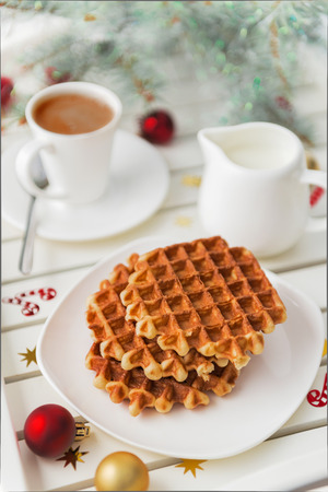 Christmas breakfast. Viennese wafer biscuit and coffee with milk Stock Photo
