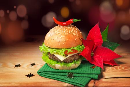 Fresh hamburger and christmas decor with poinsettia flower.