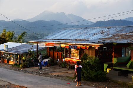 darling: Small village at Gun Darling with mount Sibayak background. Indonesia.