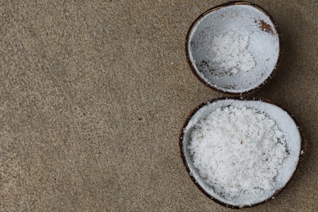half of coconut shell after grated by coconut grater photo