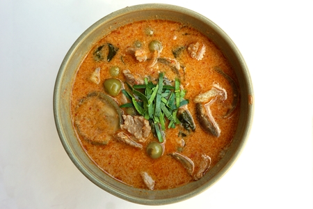 isolated of hot Thai curry with pork photo