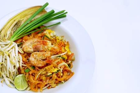 stir fried Thai style small rice noodles with shrimp,bean curd ,bean sprouts, presereved radish and ground peanuts photo
