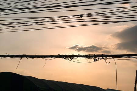 disarrangement: sunset with the disarrangement of electric wire Stock Photo