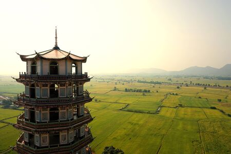 Chinese tower style with rice field background photo