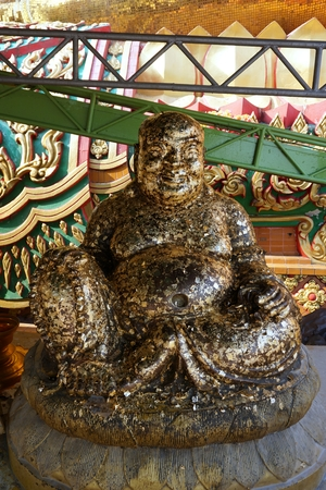 happy Buddha statue represent of lucky and wealthy photo