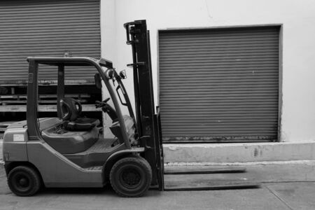black and white forklift in the factory photo