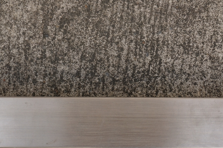 abstract cement floor with horizontal stainless tube line photo