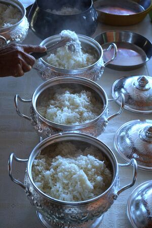 alms: put rice for offerings in a Buddhist monks alms bowl Stock Photo
