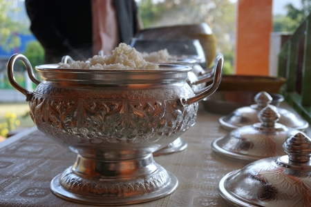 offerings: full of rice offerings in a Buddhist monks alms bowl