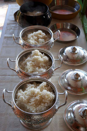 offerings: put rice for offerings in a Buddhist monks alms bowl Stock Photo