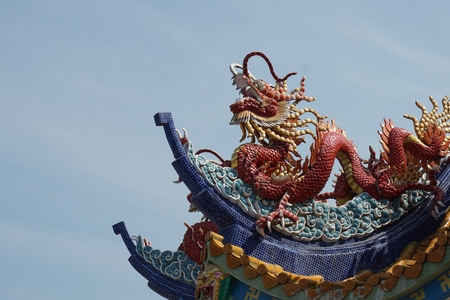 dragon on the rooftop with blue sky background photo