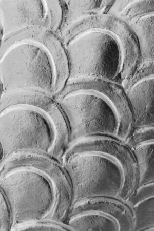 texture of gray stucco of fish scale photo
