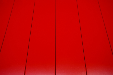 worn structure red: abstract of red wood lath for background used Stock Photo