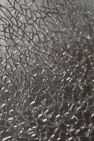 tempered: abstract crack of tempered glass on the stainless steel plate Stock Photo