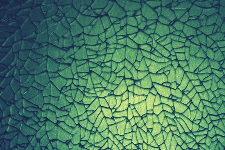 tempered: abstract crack of tempered glass on the stainless steel plate dye in green Stock Photo