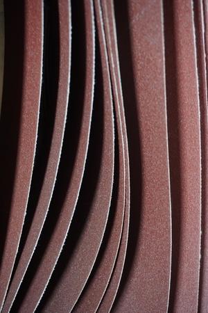 sandpaper: abstract close up of brown sandpaper belt