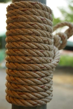 bind: abstract of binding rope bind on metal tube Stock Photo