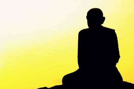 thai monk: meditation of Thai monk statue with the sunrise Stock Photo