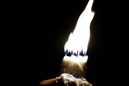 antichrist: abstract of holding candles with bare hand