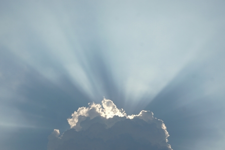 spiritual background: abstract of sunburst in cloud for background used Stock Photo