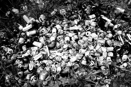 landfills: dump of light bulbs on the roadside make the pollution problem Stock Photo
