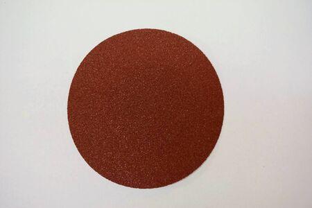 pcs: sand paper density 100 pcs per square inch on white background