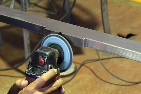 worker used the polishing machine to polish the metal work Stock Photo