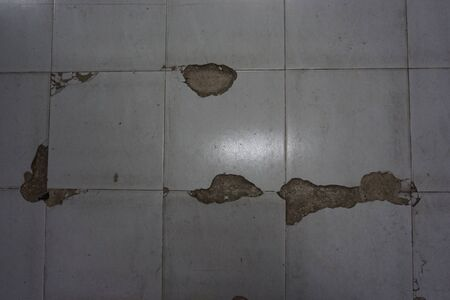 abstract of damage floor tiles for background used Stock Photo