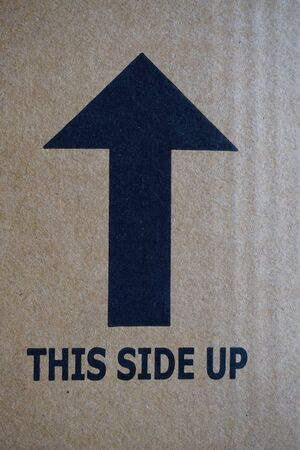 label tag: close up this side up sign print on the carton box