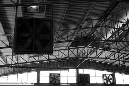 close up black and white old factory fan