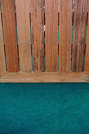 green carpet: close up wood board on green carpet  for background used Stock Photo