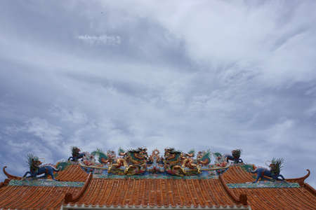 ancient architecture: close up dragon statue on chinese roof top