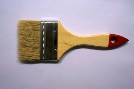 redecorate: close up paint brush on the white background Stock Photo
