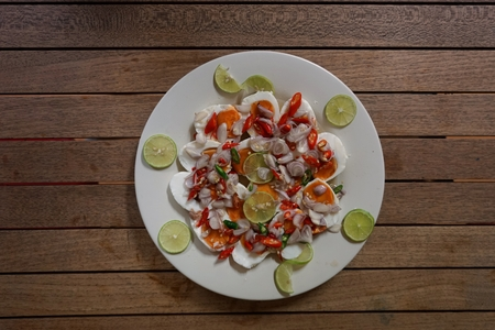 tangy: Hot and  tangy salad with salted eggs Stock Photo