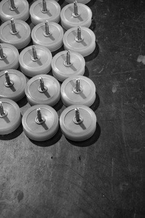 furniture hardware: abstract group of plastic wheels in the factory Stock Photo
