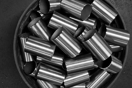 group of metal tubes collect in basket Stock Photo