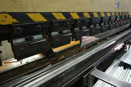 punch press: the press machine working to press the tube in factory
