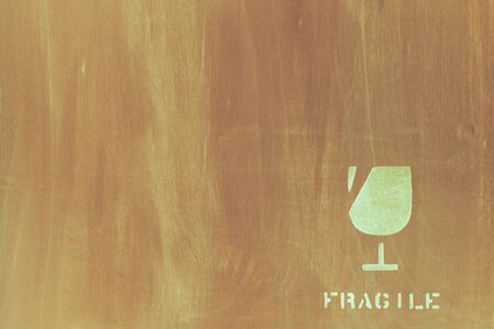 fragile icon on wood board for background used Stock Photo