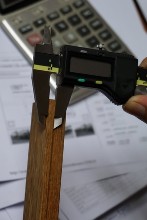 thickness: used digital vernier caliper for check the product thickness Stock Photo
