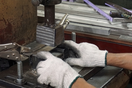 stamping: worker work on sheet metal stamping process in factory Stock Photo