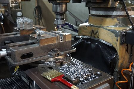 used milling machine in product process to get the correct size Stock Photo