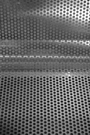 meshed: abstract of round metal mesh texture for background used
