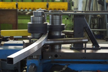 working of bending tube machine in the factory Imagens