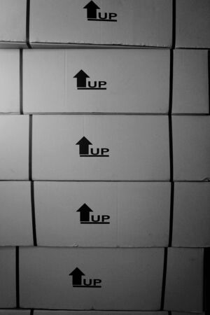 prin: stack of this side up symbol prin ton the carton boxes Foto de archivo